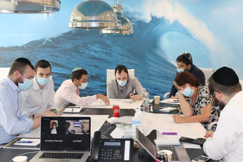 Employees working at a table